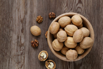 walnuts for a healthy diet on a wooden table