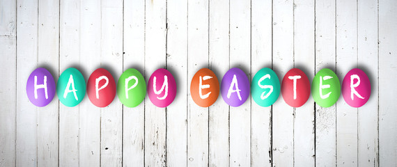 colored eggs with letters forming the word easter on white background