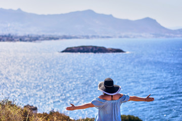 Beautiful woman in beach hat enjoying sea view with blue sky at sunny day in Bodrum, Turkey. Vacation Outdoors Seascape Summer Travel Concept