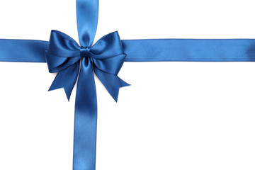 Beautiful gift blue bow with ribbon isolated on white background.