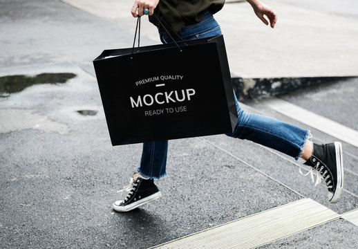 Person Crossing the Street with Black Shopping Bag Mockup