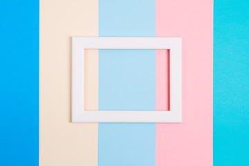 Abstract pastel colorful paper background with white wooden frame