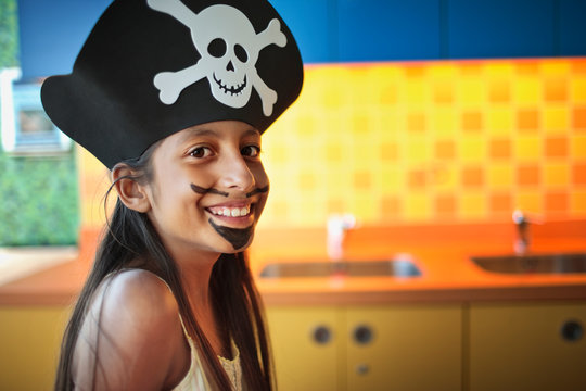 Portrait of young girl dressed up as a pirate.