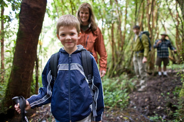Young boy happy to be hiking with his family