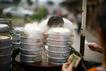 Steamed food being prepared.