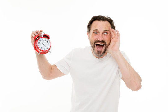 Stressful times. Man bearded mature guy hold clock isolated on white. Man with beard check what time is it. Time management skills. Personal schedule and daily regime. Alarm clock morning time