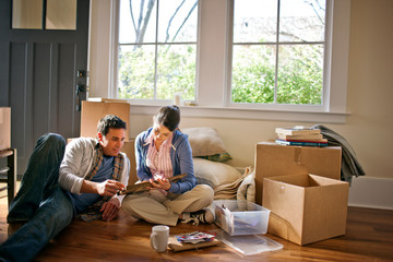 Couple moves into new house and begins unpacking