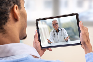 virtual live chat with the patient with digital tablet and a doctor via internet. In-home care for...