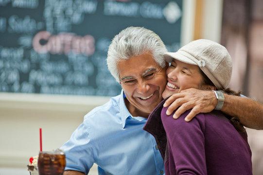 Smiling mature man hugging his daughter.