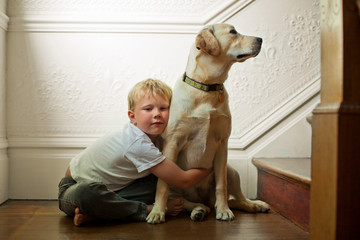 Portrait of a young boy and his dog.