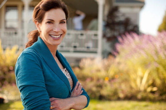 Portrait of smiling mature woman in her backyard.