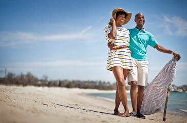 Couple standing at beach together.