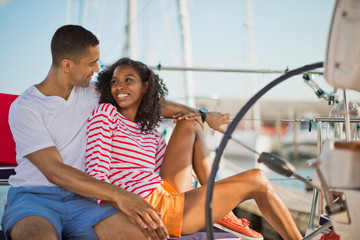 Young couple relaxing and having fun while sailing.