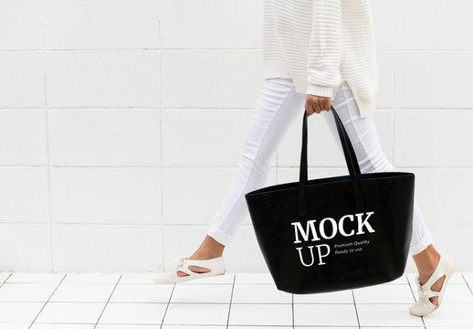 Person Walking with Black Tote Bag Mockup