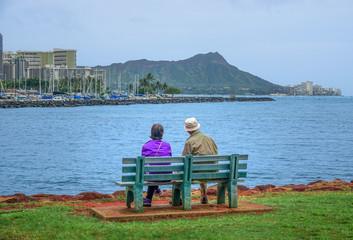 Couple enjoying the Honolulu's harbor in Oahu, Hawaii