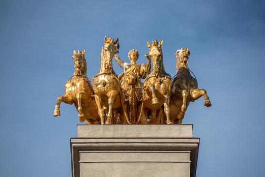 The golden horse figures of the Cascada Monumental in the Ciutadella Park in Barcelona, Spain.