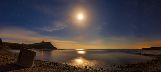Kimmeridge moon shine, rocky shores and reflections