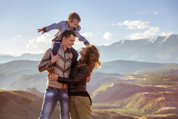 Happy family with son in mountains