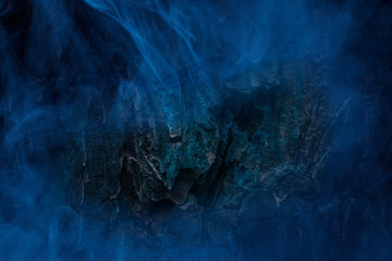 dark tree trunk at night covered mystical blue fog abstraction for design