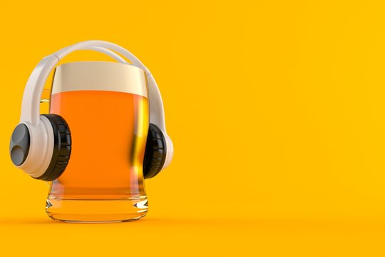 Glass of beer with headphones