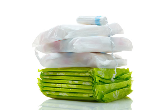 Clean white cotton tampon and pads isolated on a white.  Woman hygiene protection in period. Menstruation cycle, critical days concept.