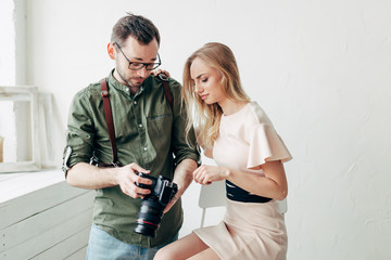 girl isn't satisfied with photos,angry unhappy model showing her negative emotion to a photographer
