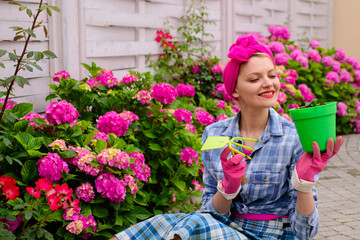 happy woman gardener with flowers. Flower care and watering. soils and fertilizers. Greenhouse flowers. woman care of flowers in garden. hydrangea. Spring and summer. Work for you