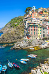 Boats on the sea with the historic architecture of Cinque Terre
