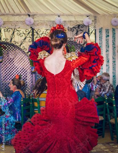 c7960992d34c Young and beautiful women wearing flamenco dresses and dancing