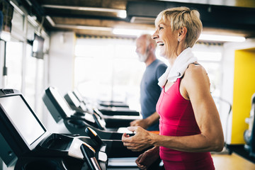 Picture of senior people running on treadmill in gym
