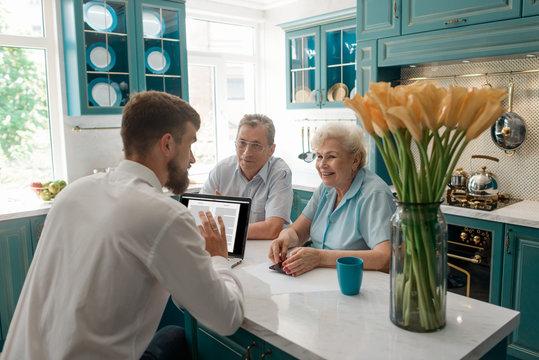 Financial advisor talks with clients