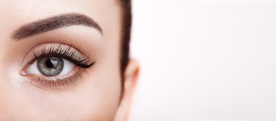 Female Eye with Extreme Long False Eyelashes. Eyelash Extensions. Makeup, Cosmetics, Beauty. Close up, Macro Wall mural
