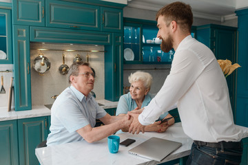 Advisor and clients shaking hands