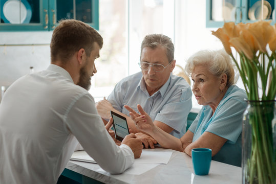 Adult son showing old parents