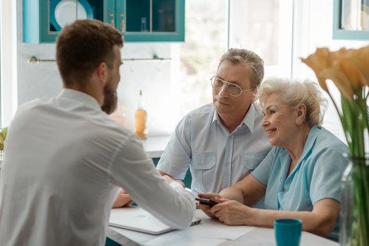 Seniour couple meeting an advisor