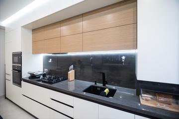 Fototapeta Modern kitchen interior in new luxury home obraz