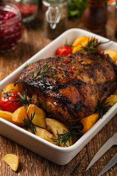 Roasted whole shoulder, with potatoes, peppers and tomatoes. Marinated in white wine.