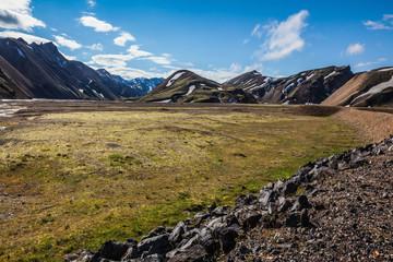 Green  rhyolite mountains surround the valley