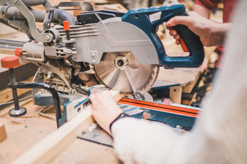 Carpentry workshop - work on a circular saw