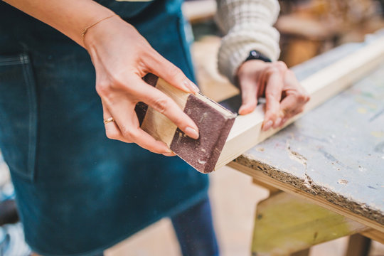 The girl in the carpentry workshop learns to work with wood