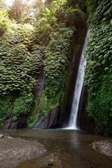 a waterfall in Bali Indonesia