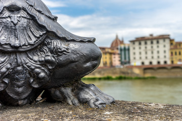 The base of the lamp post near Ponte Vecchio over the Arno River in Florence, Italy Wall mural