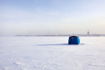 tent for winter fishing on the river