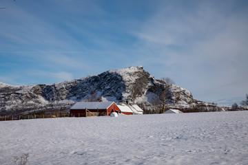 Old farm in Norwegian winter landscape