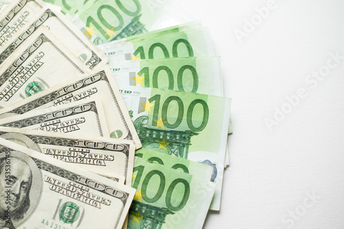 US dollars and euro banknotes texture  white Background of
