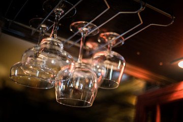 Hanging wine glasses in a pub