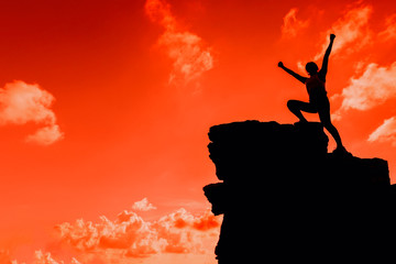 Keuken foto achterwand Rood Silhouette Sporty woman climbing on the cliff. Success and goal concept. Strong and healthy for outdoor activity.