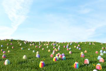 Viele Ostereier auf Wiese zu Ostern