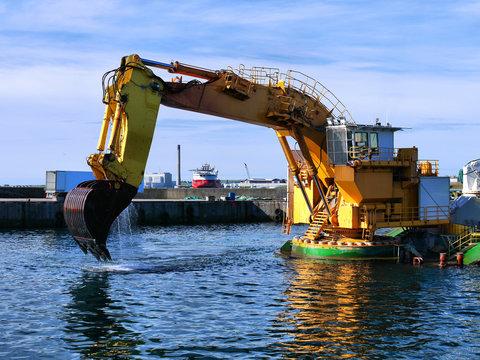 """Backhoe Dredger """"MP40"""" dredging operations in harbour."""
