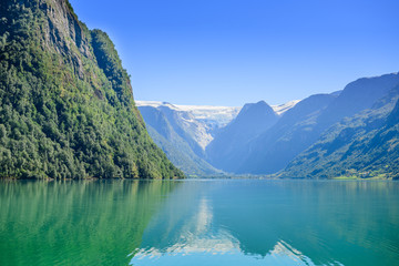 Travel in Norway fjord nature near mountain and water